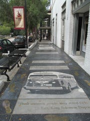 An image of a 1956 city bus is one of the dominant images on Tallahassee's heritage sidewalk, which pays tribute the Tallahassee civil rights movement, including the 1956 bus boycott. The sidewalk, on East Jefferson Street between City Hall and the county courthouse, was dedicated on Sept. 30, 2013.