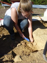 Archeology students uncover artifacts on a dig in Israel