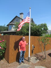 In the spirit of Flag Day, Ron Etzel of Sublimity shared stories about the 105-year-old flagpole erected in his yard. The pole once towered above the belfry of the historical Sublimity City Hall built in 1912.