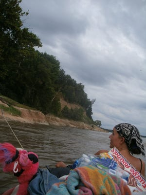 Susan Wilson overlooks the Louisiana bluffs while drifting down the Mississippi River in a canoe. Wilson and friend George Garrett traveled from West Lafayette to Baton Rouge, Louisiana, by canoe.