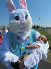 The Easter Bunny cuddles a baby at a previous Easter