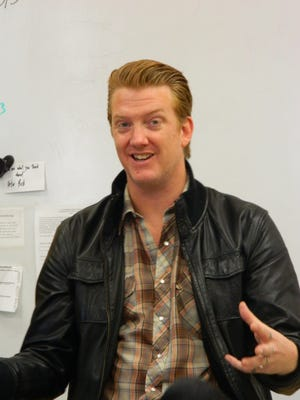 Josh Homme, shown here at a 2013 appearance at his Palm Desert High School alma mater, is trying is hand at comedy after his Halloween show with Queens of the Stone Age in Inglewood.