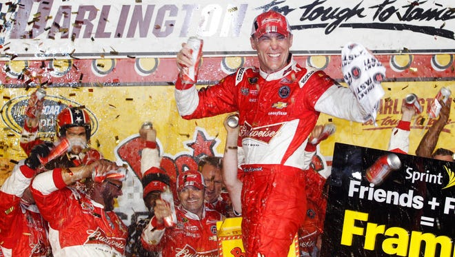 Kevin Harvick celebrates in victory lane after winning the Southern 500 at Darlington Raceway.