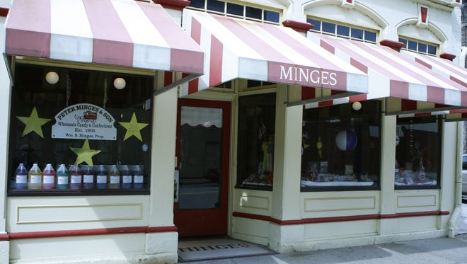 Police arrested a man early Monday after finding him inside Peter Minges & Son candy store on West Court Street.