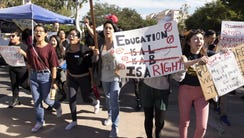 University of California, Irvine students hold signs