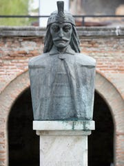 A statue of Vlad the Impaler in the Old Town in Bucharest,