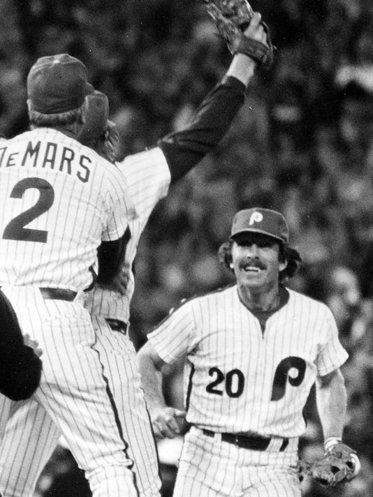 FILE - In this Oct. 21, 1980, file photo, Philadelphia Phillies third baseman Mike Schmidt (20) races to celebrate with relief pitcher Tug McGraw, back left, and coach Billy DeMars (2) after winning Game 6 to clinch baseball's World Series against the Kansas City Royals in Philadelphia, Pa. It is that time of year, late October, and World Series talk is in the air and Schmidt says the jinx will not affect the Chicago Cubs or the Cleveland Indians. (AP Photo, File)
