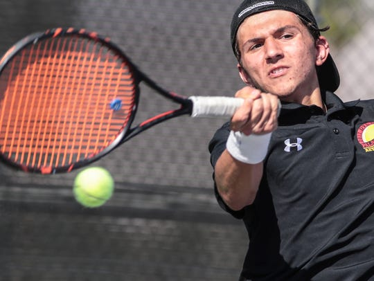Palm Desert's Christian Rozpedski returns the ball