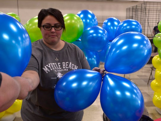 Wendy Giulivo of Elizabethtown gathers ballons for