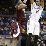 With 31 points, LSU's leading scorer and guard Antonio Blakeney (2), shoots for 3 over Mississippi State guard Fred Thomas (1) during Saturday's game.