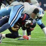 Texans quarterback Brian Hoyer is sacked by Titans outside linebacker Brian Orakpo during the first half in Houston on Nov. 1, 2015.