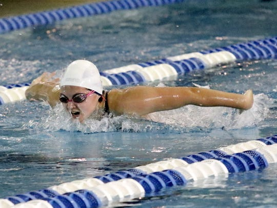 Summer Pierce of Owego Free Academy swims to the 17th-fastest preliminary time in the 100-yard butterfly Friday at Ithaca College.