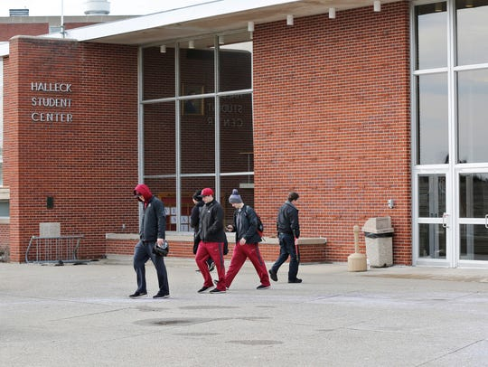 Students walk out of  the Halleck Student Center Friday,