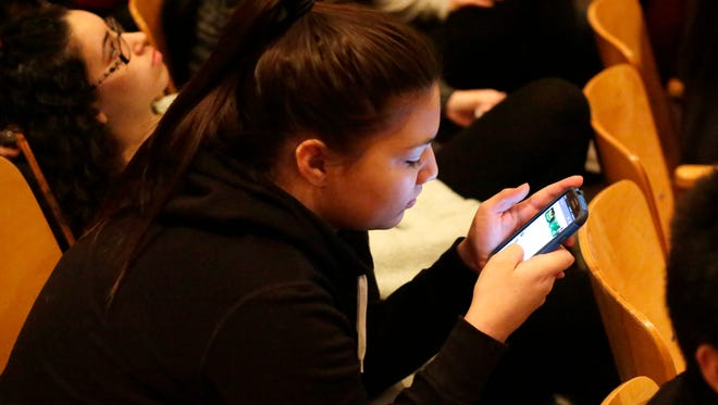 Sheboygan South sophomore Jocelyn Morales, 16, texts on her phone Wednesday January 13, 2016 before a presentation on the dangers of texting and driving.
