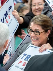 Melinda Fox, of Harrisonburg, Va., a member of the Republican Women of Harrisonburg and Rockingham County, shows her excitement to meet Republican vice-presidential nominee Indiana Gov. Mike Pence, left, at a rally on the Rockingham County Fairgrounds Wednesday, Oct. 5, 2016, in Harrisonburg, Va. (Nikki Fox/Daily News-Record via AP)