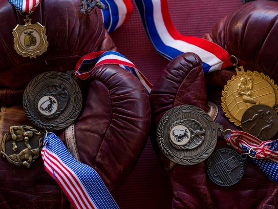 An old pair of boxing gloves holds the 7 medals found