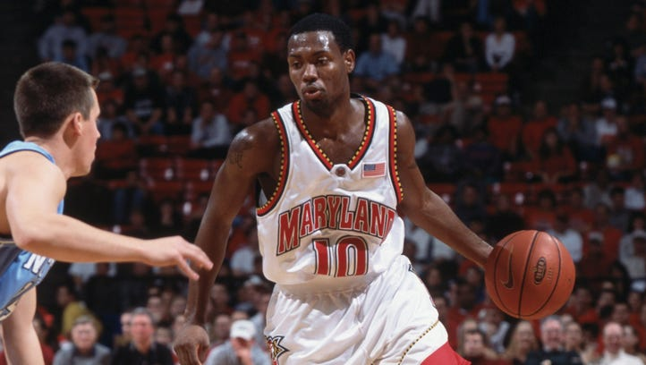 In 2002, Andre Collins (10) of the Maryland Terrapins dribbles the ball against the North Carolina Tarheels during the ACC Conference basketball game at Cole Field House in College Park, Maryland.  Maryland crushed North Carolina 112-79.
