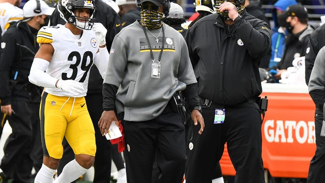 """FILE - In this Sunday, Nov. 1, 2020 file photo, Pittsburgh Steelers head coach Mike Tomlin looks on during the second half of an NFL football game against the Baltimore Ravens in Baltimore. A person with knowledge of the matter told The Associated Press that Tomlin has been fined $100,000 and the club $250,000 because coaches improperly wore facial coverings last Sunday. The person said Friday, Nov. 6 that Tomlin and the Steelers were disciplined because members of the coaching staff were """"not wearing face coverings at all times on the sidelines."""" (AP Photo/Terrance Williams, File)"""
