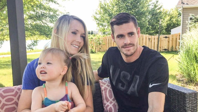Olympic gold medalist in diving, David Boudia, his wife Sonnie, and daughter Dakoda chat with IndyStar reporter David Woods at Boudia's West Lafayette Indiana home, Tuesday June 28th, 2016.