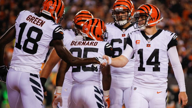 Cincinnati Bengals quarterback Andy Dalton (14) and Cincinnati Bengals wide receiver A.J. Green (18) shake hands in celebration of Green's touchdown in the second quarter during the NFL game between Miami Dolphins and the Cincinnati Bengals, Thursday, Sept. 29, 2016, at Paul Brown Stadium in Cincinnati.