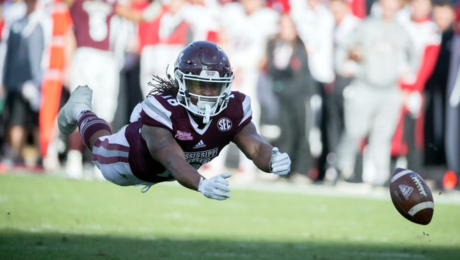 Mississippi State wide receiver Deddrick Thomas dives for an errant pass in last year's Tax Slayer Bowl. Thomas said there is a communication issue with the Bulldogs' offense this season, which has led to even more passing woes. (AP Photo/Stephen B. Morton)