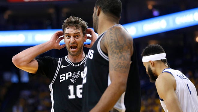 San Antonio Spurs center Pau Gasol (16) reacts after being called for a foul against the Golden State Warriors in the second quarter in game one of the first round of the 2018 NBA Playoffs at Oracle Arena.