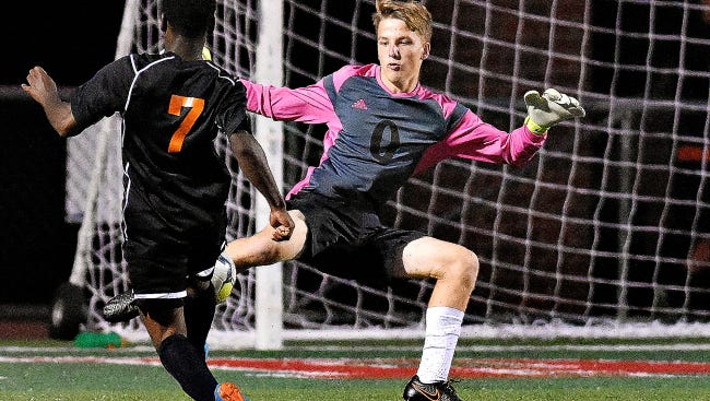 Central York's Pierce Miller, left, looks to kick the ball past Susquehannock's Aaron Bilbie, right, during recent soccer action at Susquehannock High School. Susquehannock will play a state AA semifinal contest on Tuesday in Altoona vs. South Park.