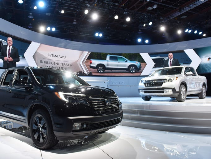 The Ridgeline Black Edition, left, and standard Ridgeline