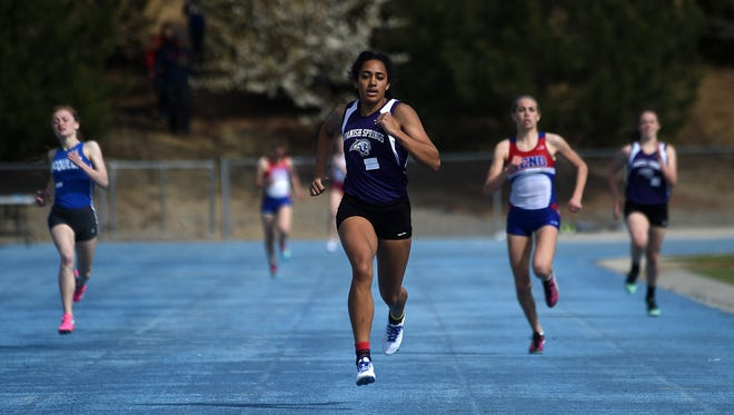 Spanish Springs junior Jessica Ozoude, middle, sprints away from her competitors to win her 400 meter heat during a track and field meet at McQueen on Saturday.