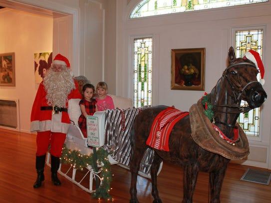 Santa with Arlandria Vasquez and Zaylec Quirarte.