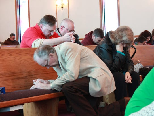 Guests and members of Pinson Baptist Church pray for