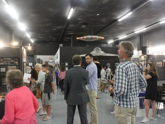 Attendees visit the UFO Museum during the second day