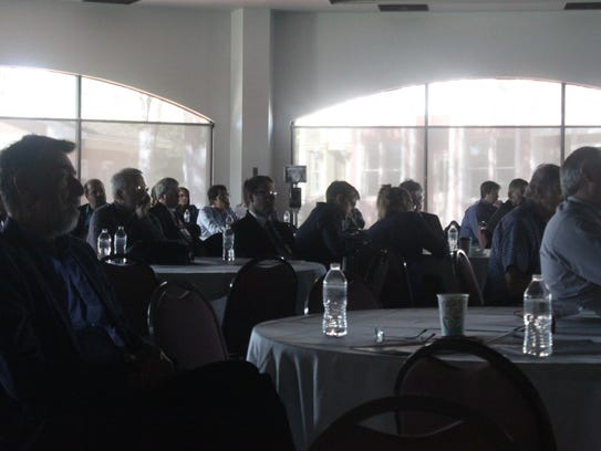 Attendees from across the world listen to a talk during