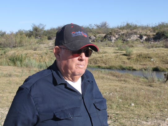 Jim Davis surveys his land along the banks of the Black