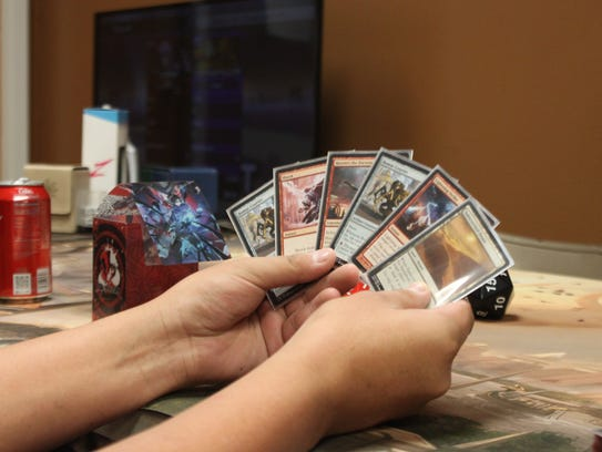 A player readies his cards during a Magic the Gathering