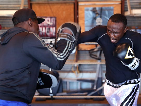 Habib Ahmed works out with his coach, Ofori Asare,