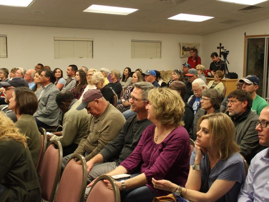 Residents and local leaders listen to Carlsbad's municipal