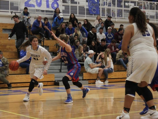 Carlsbad point guard Mariel Gomez looks for an opening