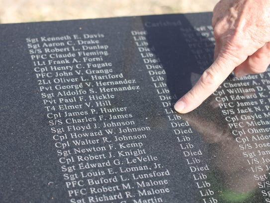 Joanna Sieberg points out her father's name on a memorial