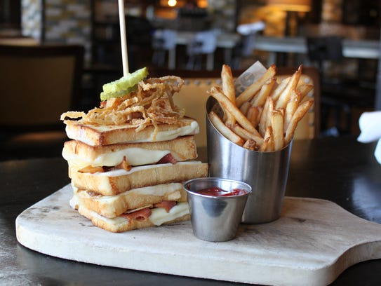 The Office Tavern Grill is offering this monstrous 15-layered grilled cheese for National Grilled Cheese Day.