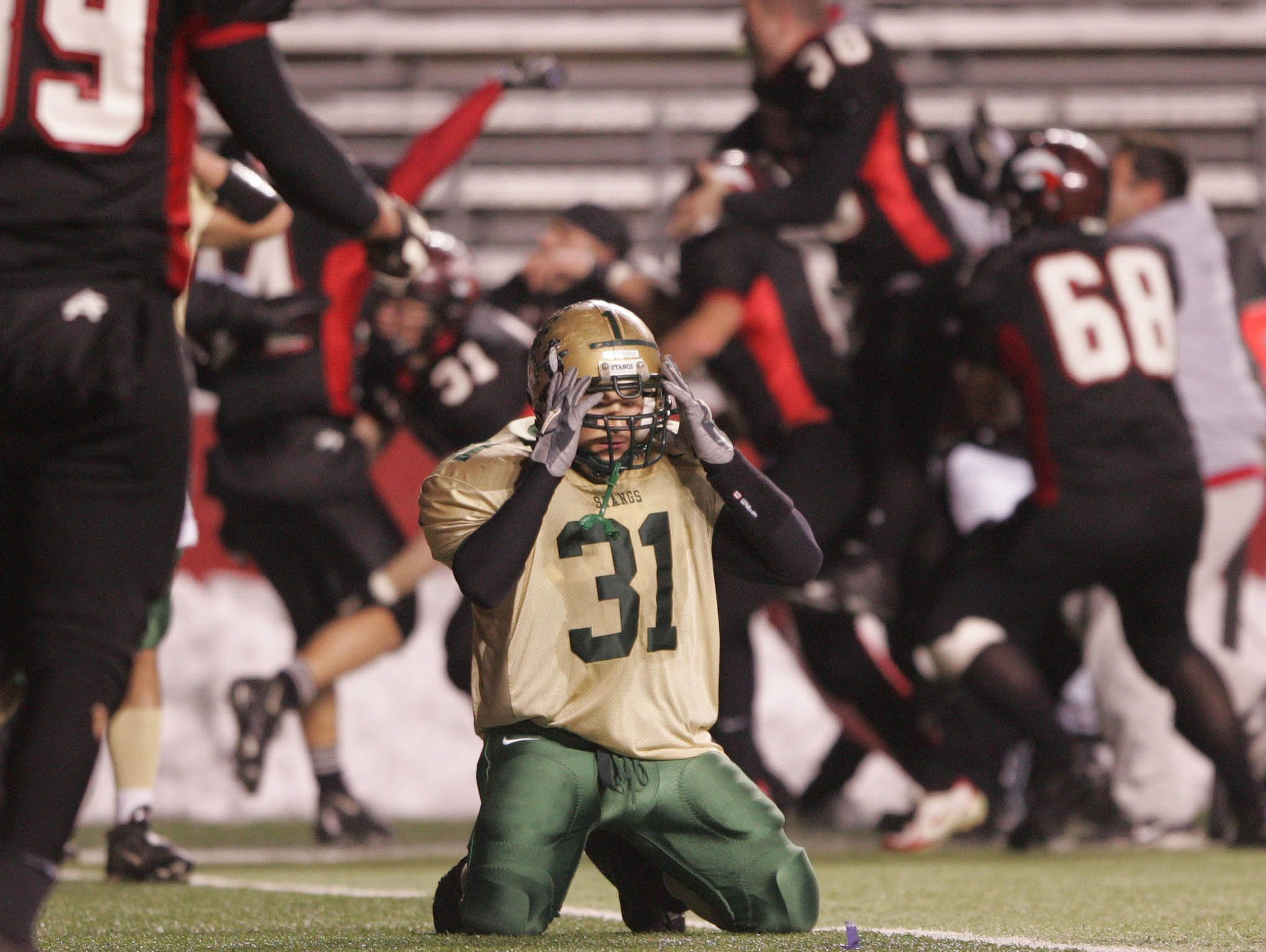 Brick Memorial's Daniel LaBrutto (31) reacts as Jackson celebrates their come-from-behind win in 2005.