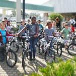 Photos: Academy Sports & Outdoor store gives 50 bikes to students