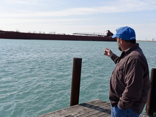 Matt Winkler talks about the freighter traffic and damage their side wake can do on resident's docks Friday, April 14, at his home on Harsens Island.