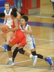 Cooper's T'Kiya Smith, right, defends against a Lubbock