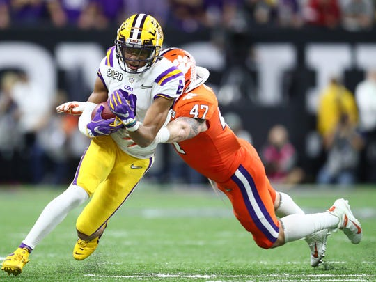 LSU Tigers wide receiver Justin Jefferson (2) is tackled by Clemson Tigers linebacker James Skalski (47) in the first half in the College Football Playoff national championship game at Mercedes-Benz Superdome