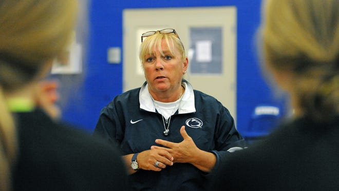 St. Joseph's head volleyball coach Jan Carino works with her team during practice Monday, September 22, 2014 at St. Joseph's High.