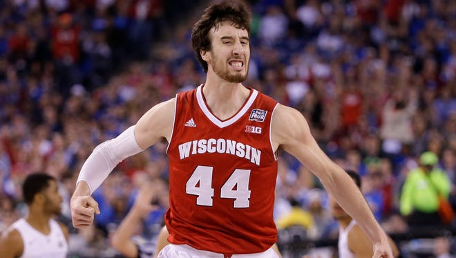 Wisconsin Badgers forward Frank Kaminsky celebrates a big first half three pointer during the Wisconsin-Kentucky NCAA Men's Basketball  semifinal game  at  Lucas Oil Stadium in Indianapolis, Indiana, Saturday, April 4, 2015.  Milwaukee Journal Sentinel photo by Rick Wood/RWOOD@JOURNALSENTINEL.COM