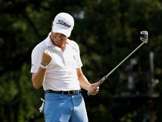 Justin Thomas celebrates after sinking a birdie on the 18th green during the final round at the BMW Championship golf tournament at Medinah Country Club, Sunday, Aug. 18, 2019, in Medinah, Ill. He finished under 25. (AP Photo/Nam Y. Huh) ORG XMIT: ILNH121