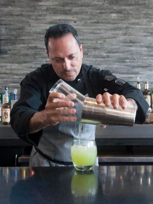 Richard Friedrich, PJW Restaurant Group's corporate executive chef, prepares an Italian lemonade (freshly squeezed lemonade, Tito's Handmade Vodka, and basil). ,