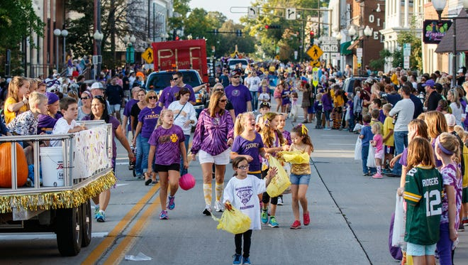 Spectators and participants fill the streets of downtown Oconomowoc during the 2015 Oconomowoc High School Homecoming Parade. This year's parade is set to start at 5:15 p.m. Friday, Sept. 29.